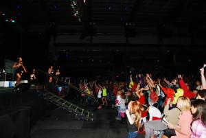 kidzbop kids throw out prizes to the crowd in Omaha Nebraska